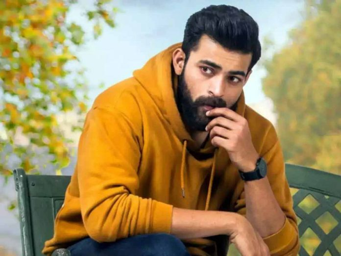 Varun Tej meticulously balancing a fidget spinner on his nose